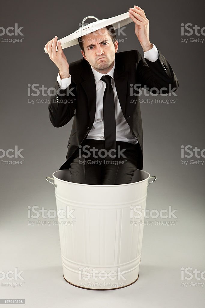 angry failure business man in trash can with cover royalty-free stock photo