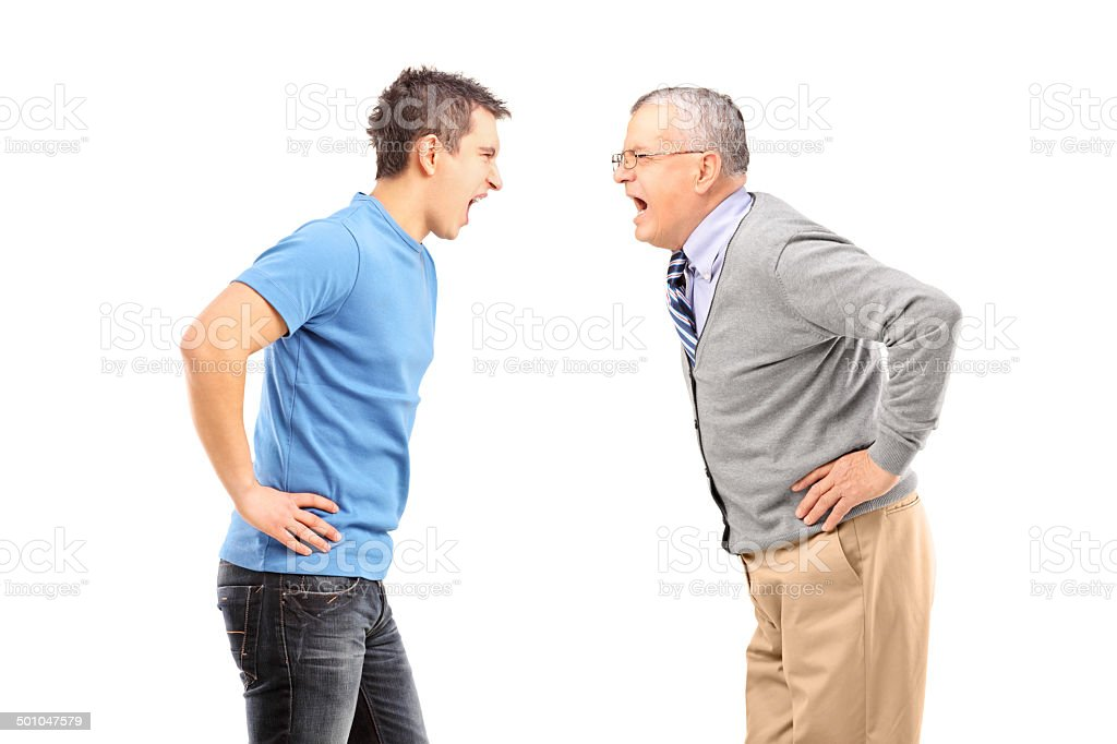 Angry father and son having an argument stock photo