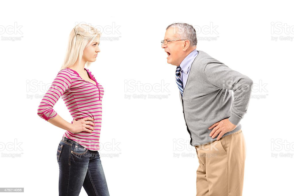 Angry father shouting at his daughter stock photo
