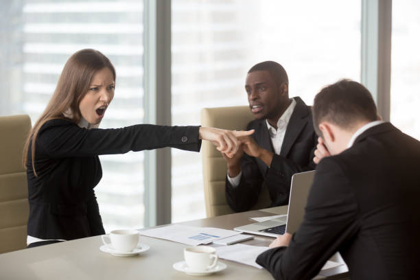 Angry female boss scolding employee, firing dismissing ineffective office worker stock photo