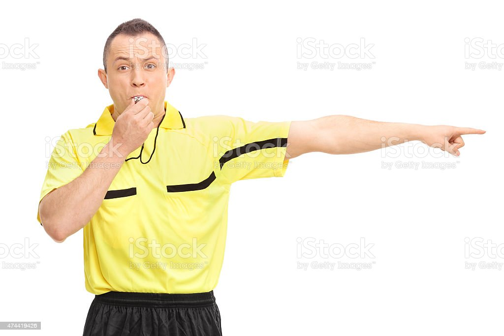 Angry football referee blowing a whistle stock photo
