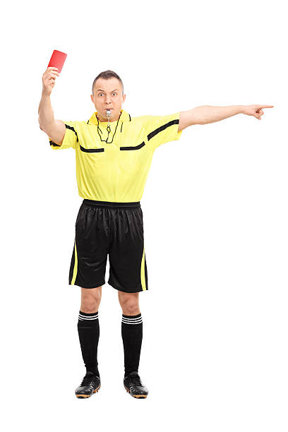 angry football referee showing a red card - judge sports official stock photos and pictures