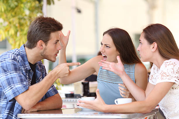 angry friends arguing in a coffee shop - arguing stock photos and pictures