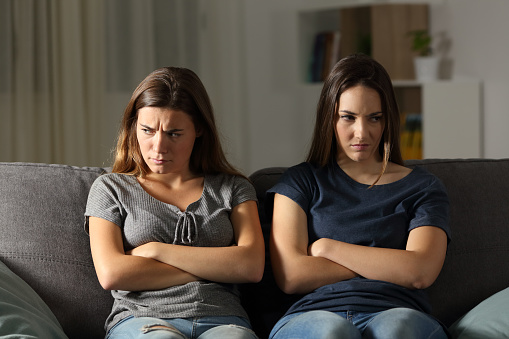 istock Angry friends ignoring each other at home in the night 964912400