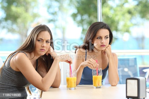 istock Angry friends ignoring each other on vacation 1155215533