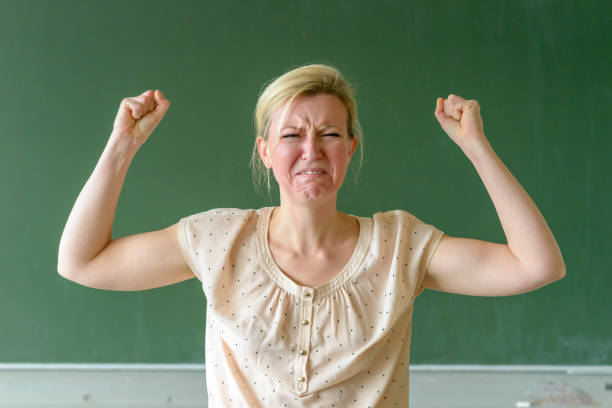 Angry frustrated school teacher throwing a tantrum stock photo