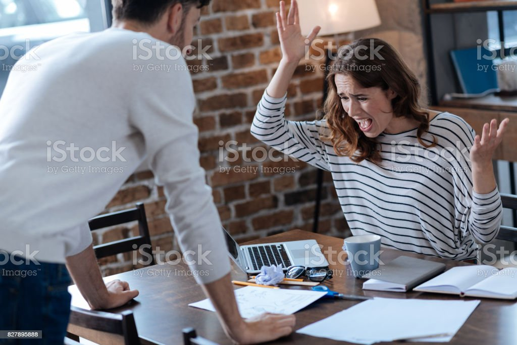 Angry furious woman gesticulating stock photo