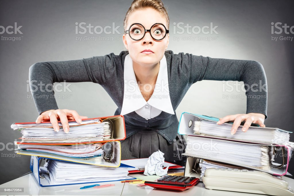 Angry furious young blonde businesswoman. stock photo