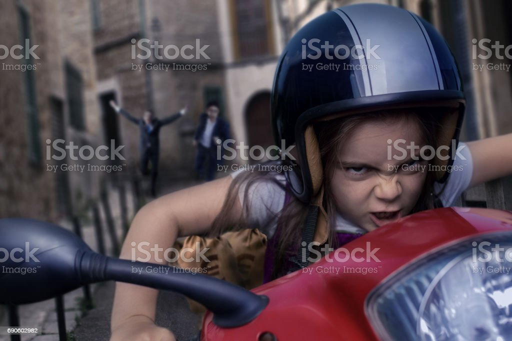 Angry girl driving motorcycle stock photo