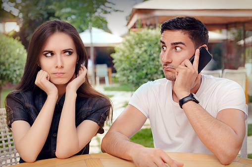 Angry Girl Listening To Her Boyfriend Talking On The Phone