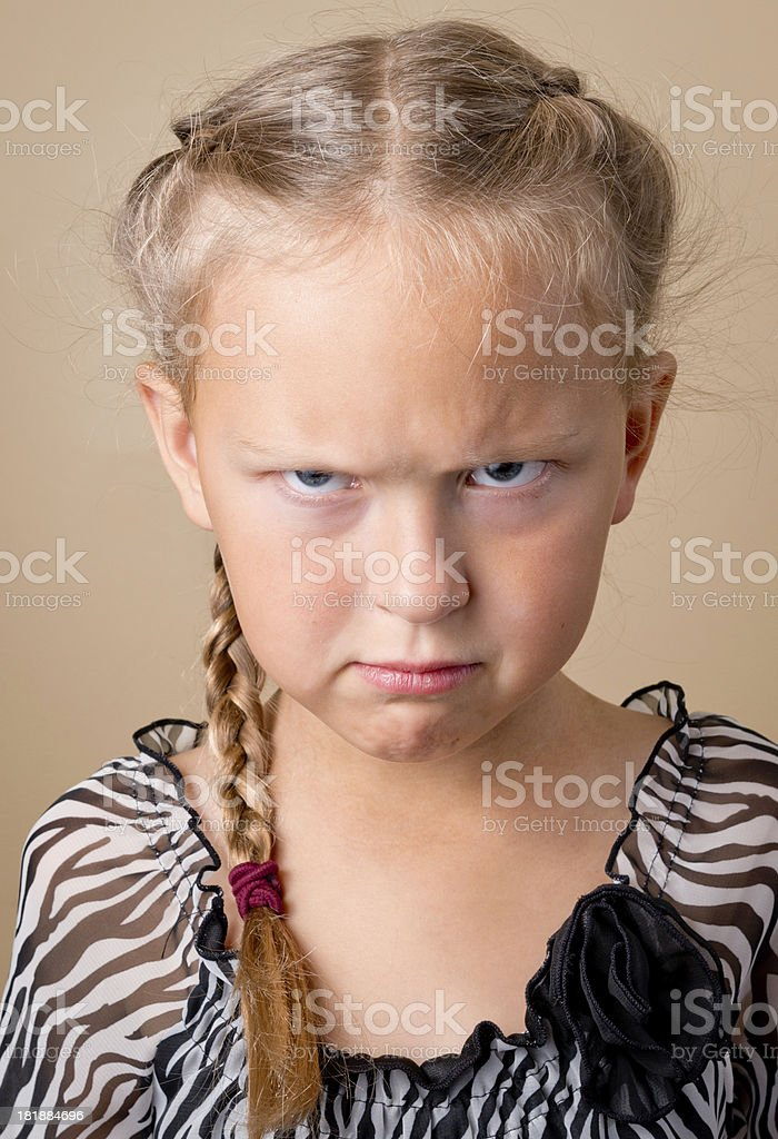 Angry Girl with French braids royalty-free stock photo