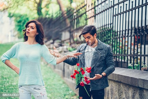 istock Angry girlfriend throwing bouquet 680544900