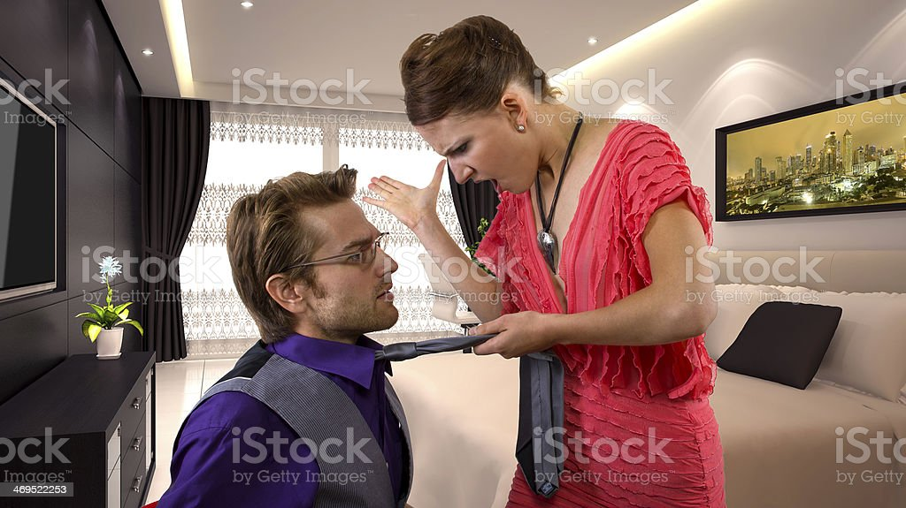Angry Girlfriend Yelling at Her Boyfriend stock photo