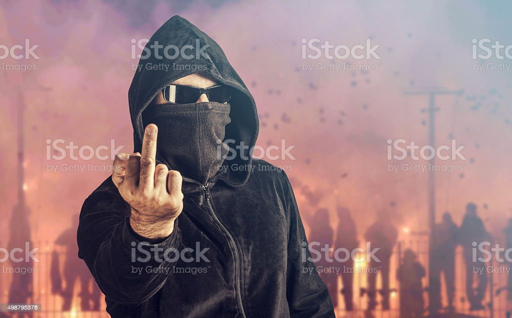 Angry hooligan showing the middle finger stock photo