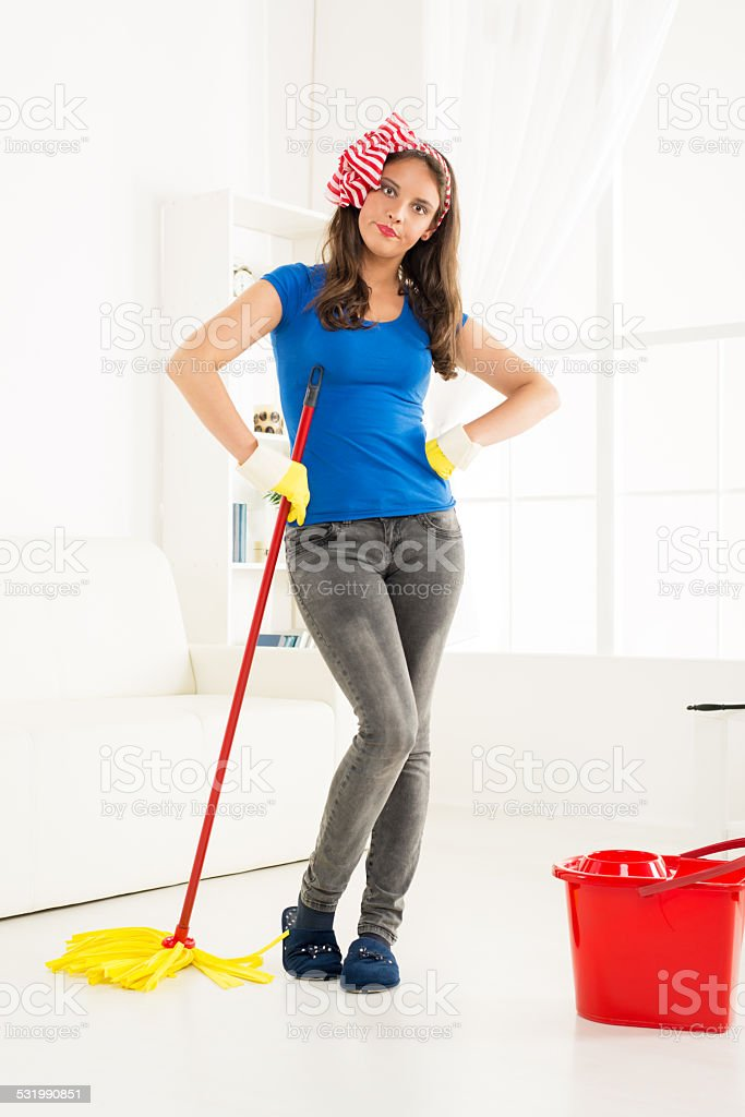 Angry Housewife With A Mop stock photo