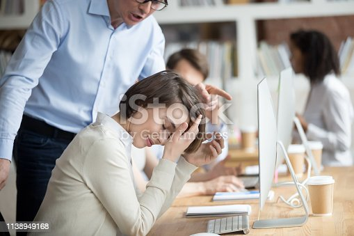 istock Angry irritated company ceo reprimanding employee female 1138949168