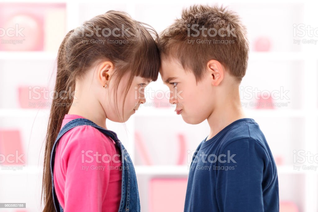 Angry kids looking at each other stock photo