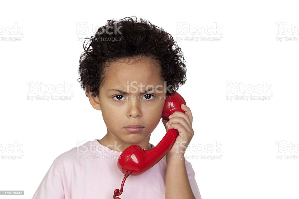 Angry latin child with red phone royalty-free stock photo