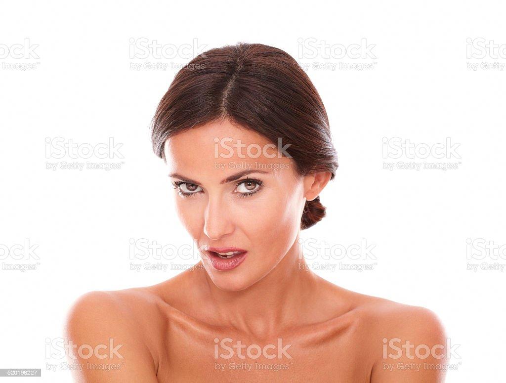 Angry latin female looking at camera stock photo