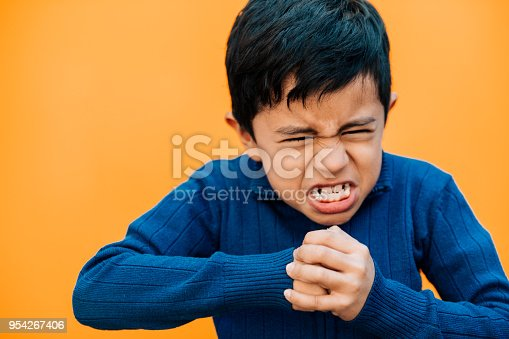 istock Angry Little boy making a fist 954267406