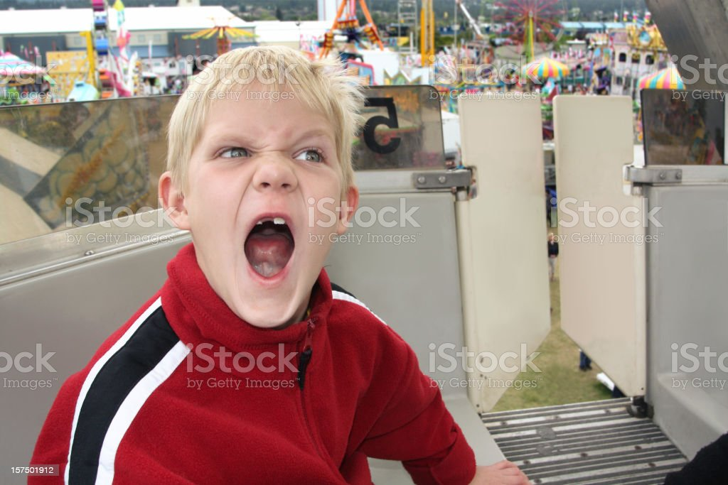 Angry Little Boy on a Ferris Wheel royalty-free stock photo