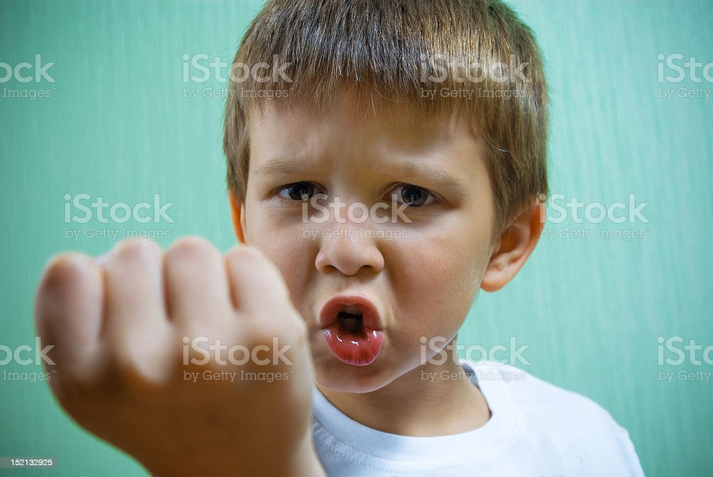 Angry little boy. stock photo