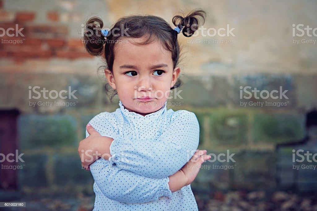 Angry little girl stock photo