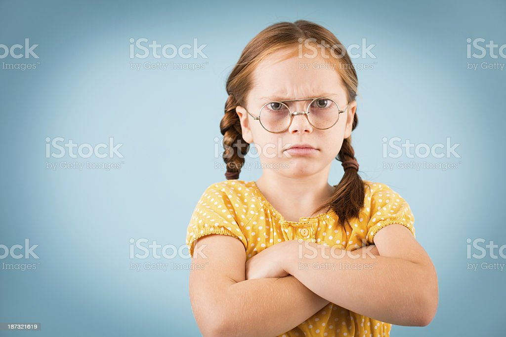 Angry Little Girl Wearing Vintage, Nerdy Eyeglasses royalty-free stock photo
