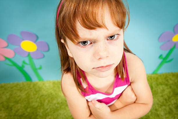 Angry Little Girl, With Red Hair, in Whimsical World stock photo