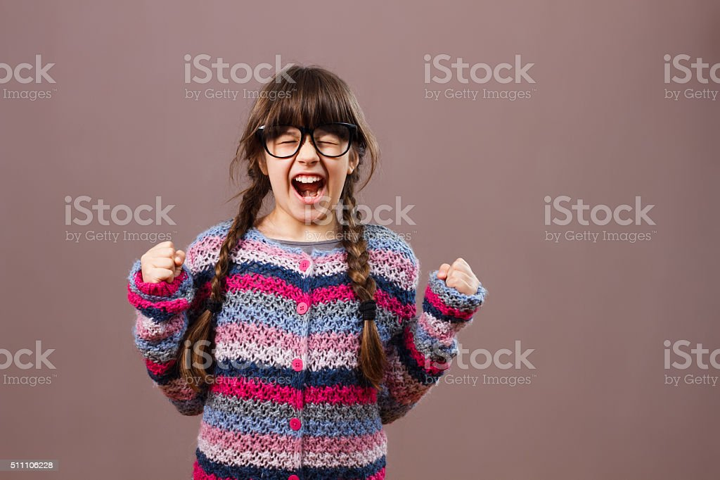 Angry little nerdy girl stock photo