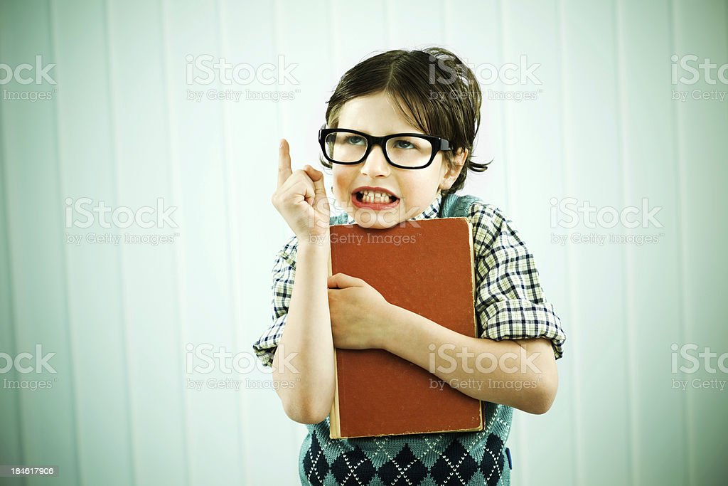 Angry looking nerd boy is pointing with his finger. royalty-free stock photo