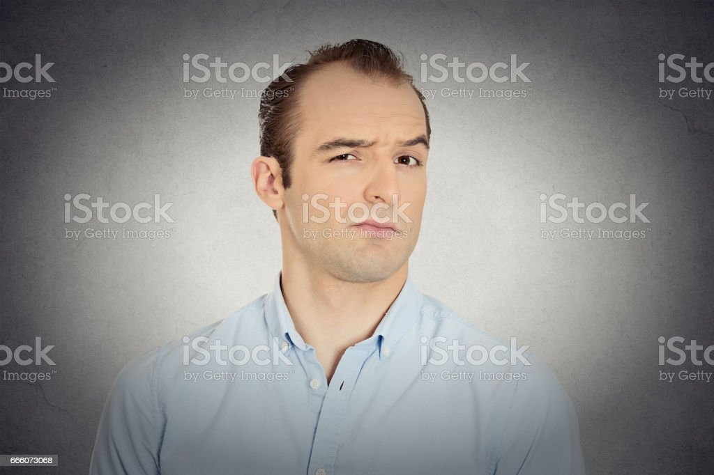 angry, mad, annoyed, skeptical, grumpy business man stock photo
