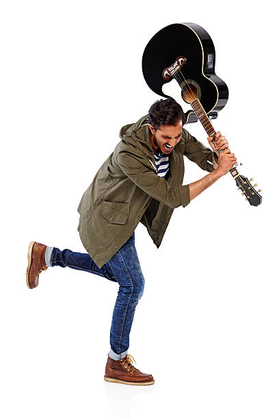angry male guitarist breaking guitar - broken guitar stock photos and pictures