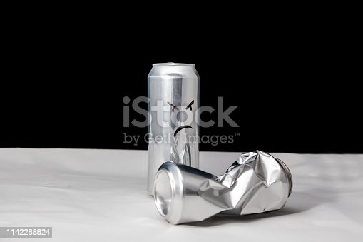 Angry man beat the weak concept. 2 aluminium cans with drawed faces Emoticons emoji