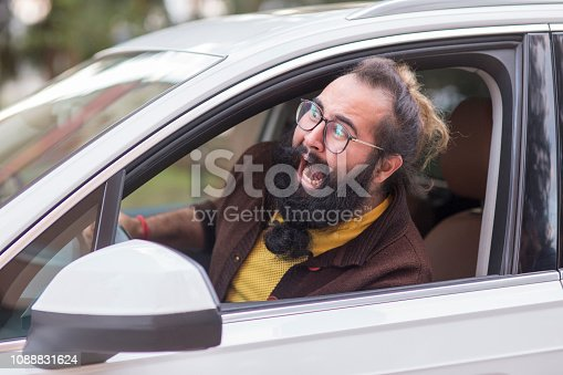 Side profile angry hipster man driver