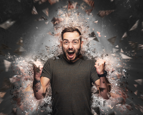 istock Angry man concept. Shattered elements exploding 914891036