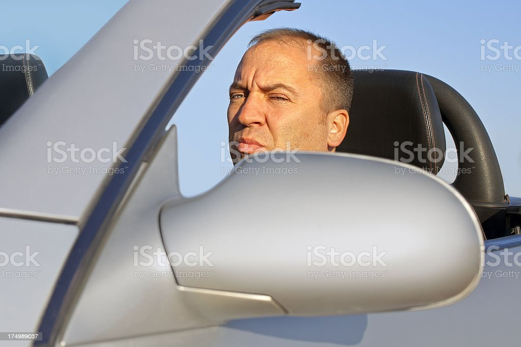 Angry man driving a sport car royalty-free stock photo