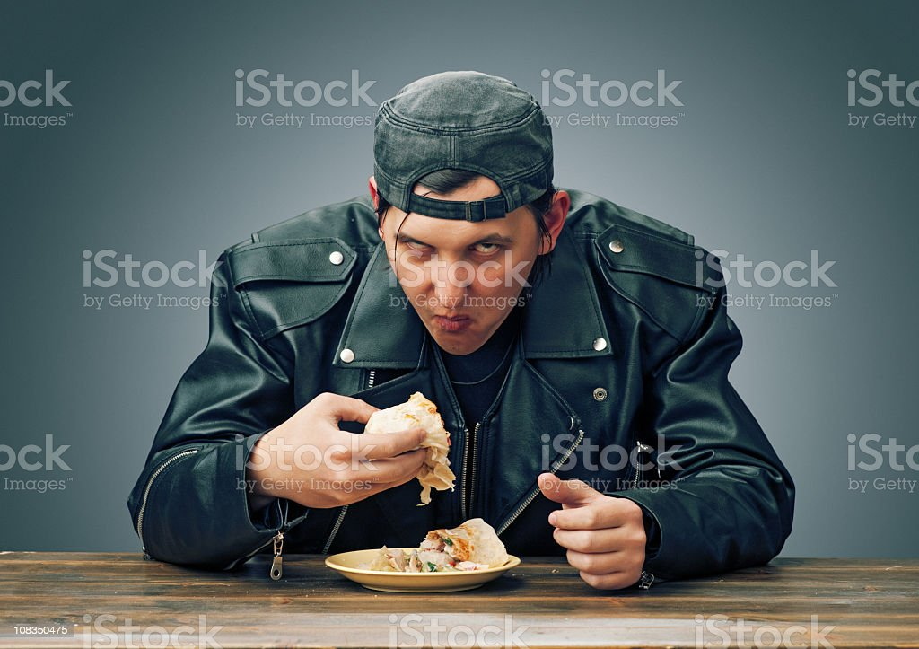 Angry man eating royalty-free stock photo