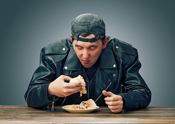 angry man eating - bordsskick bildbanksfoton och bilder