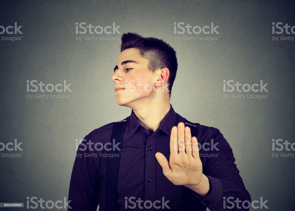 angry man giving talk to hand gesture with palm outward stock photo
