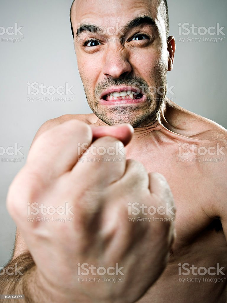 Angry Man Holding Fist Out royalty-free stock photo