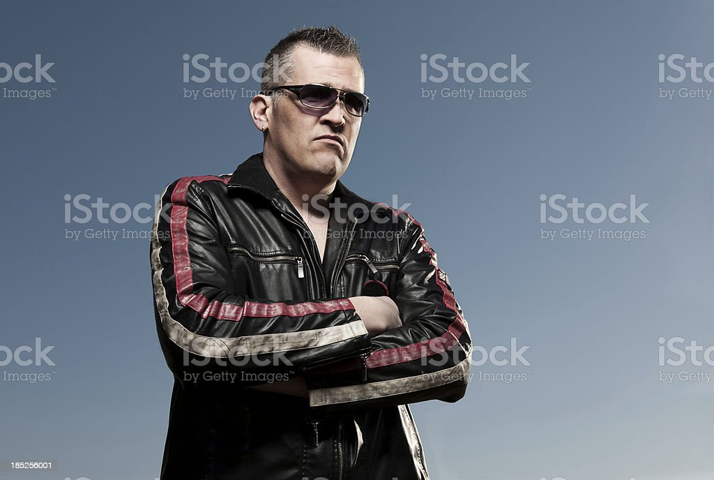 Angry man in leather jacket stock photo