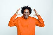 istock Angry man in orange hoodie 1307732100