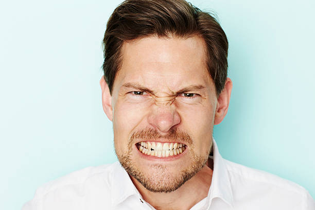 Angry man Angry man clenching teeth at camera clenching teeth stock pictures, royalty-free photos & images