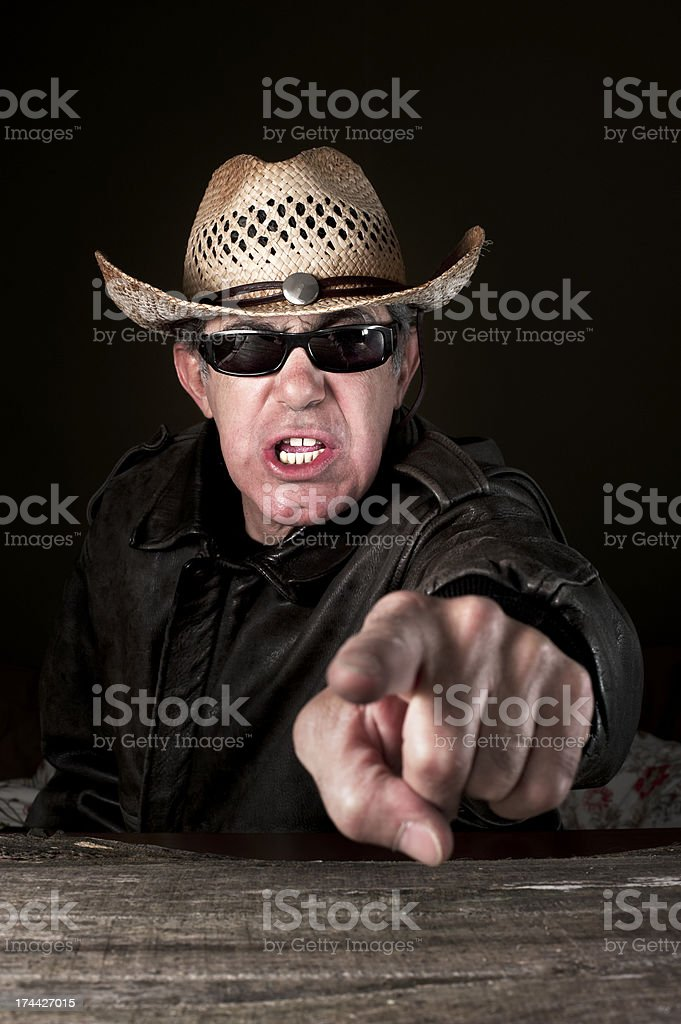 Angry man pointing and yelling royalty-free stock photo