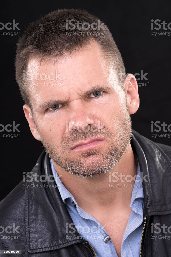 Angry man portrait on black stock photo