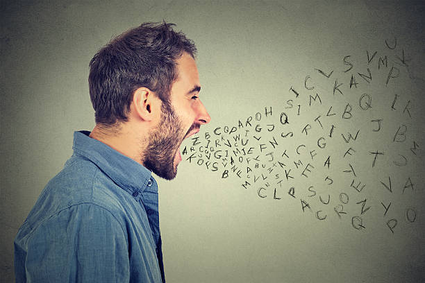 angry man screaming alphabet letters flying out of open mouth stock photo