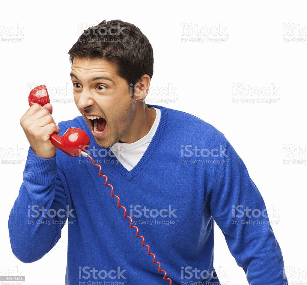 Angry Man Screaming Into Telephone Receiver - Isolated stock photo