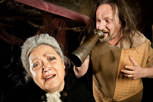 Angry man shouting an old woman stock photo