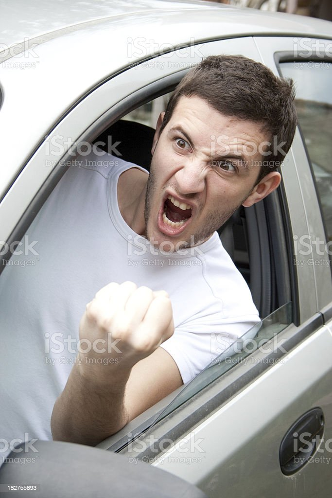 Angry man shouting from a car royalty-free stock photo